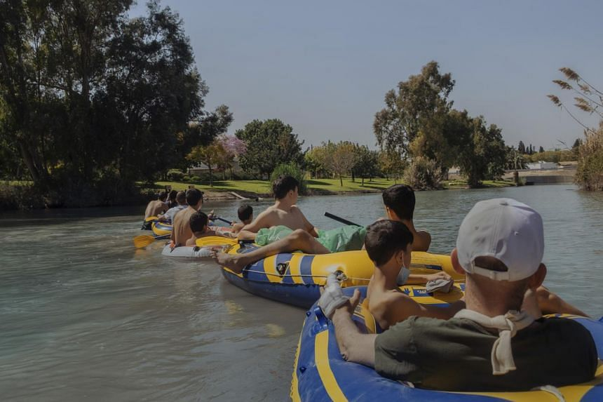 Tubers from the nearby town of Beit Shean on a section of the Asi River that flows through Kibbutz Nir David in northern Israel on April 4, 2021.