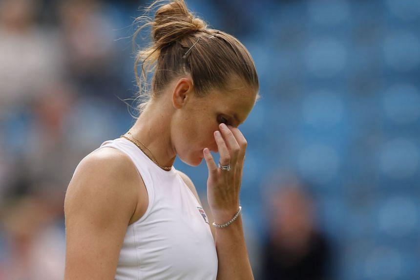 Pliskova reacts during her round of 32 match against Italy's Camila Giorgi.