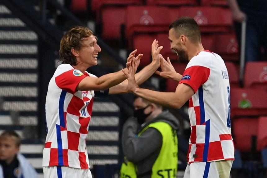 Luka Modric (left) celebrates scoring for Croatia with Mateo Kovacic.