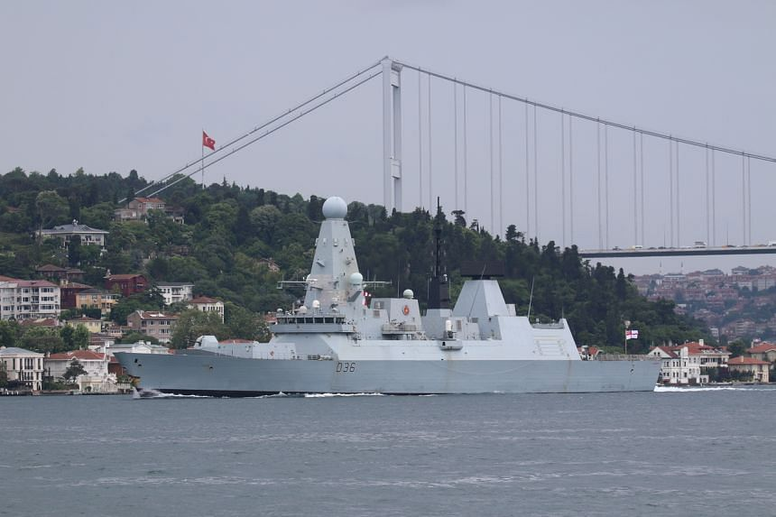 HMS Defender sailing in the Bosphorus on its way to the Black Sea, in Istanbul, Turkey, on June 14, 2021.