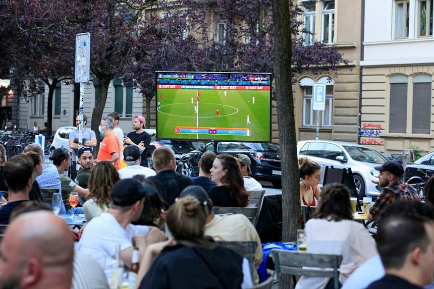 People watching the Euro 2020 match between Turkey and Italy at a sports bar in Zurich, Switzerland, on June 11, 2021.