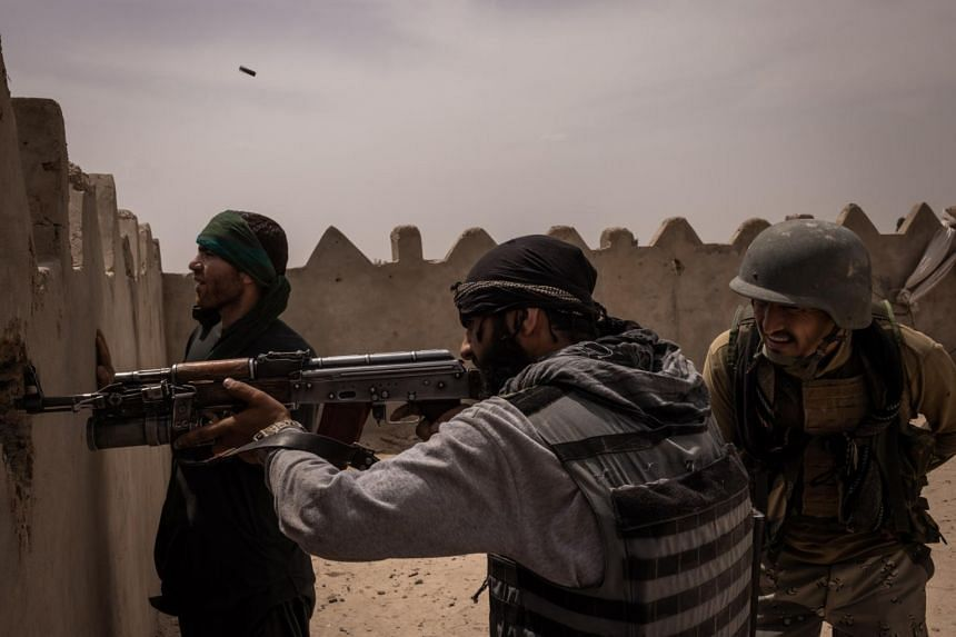 Afghan soldiers fight Taleban militants in Lashkar Gah, Afghanistan, on May 10, 2021.