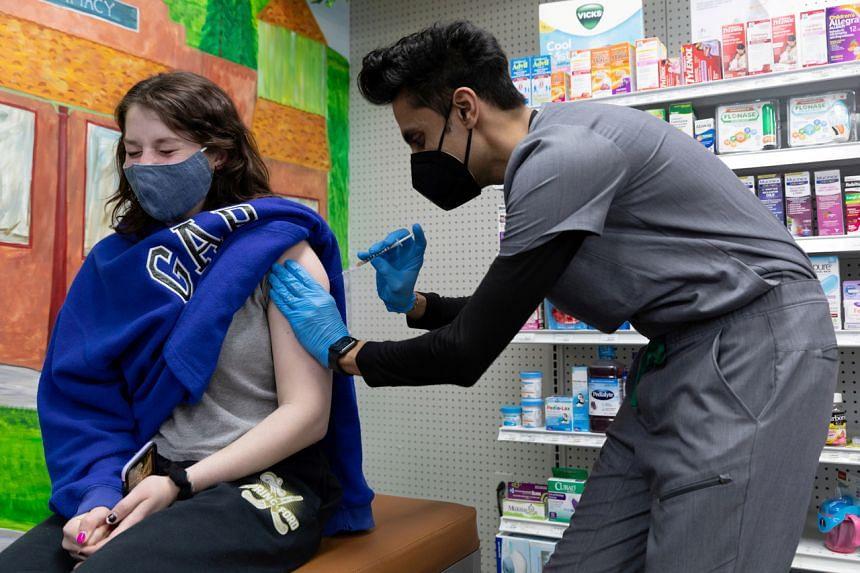 Julia Gadsby, 18, who has Lupus, receiving the Pfizer-BioNTech vaccine in Schwenksville, Pennsylvania, on March 3, 2021.
