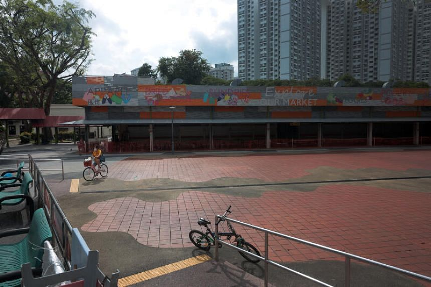 The area around 115 Bukit Merah View Market and Hawker Centre was quiet on June 22, 2021, as customers stay away.