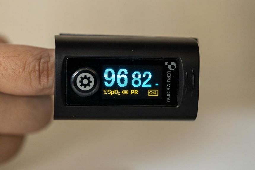 The oximeter, which measures blood oxygen levels, can be used by placing it around a finger tip and pressing a button to activate the device.