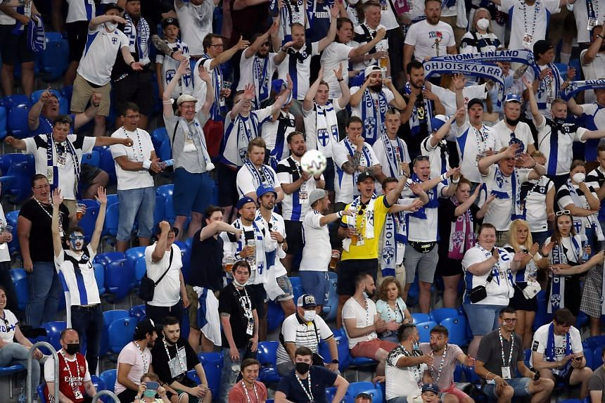 Finland fans cheer for their team during the match against Belgium in StPetersburg, on June 21, 2021.