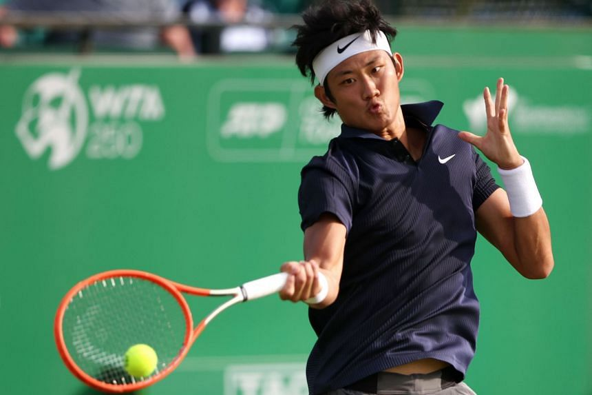 China's Zhang Zhizhen in action during the Nottingham Open tennis tournament in Britain on June 8, 2021.