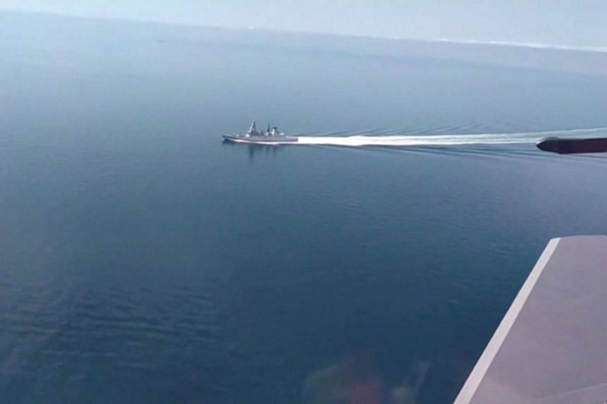 A still image taken from a video released by Russia's Defence Ministry allegedly shows Britain's HMS Defender filmed from a Russian military aircraft in the Black Sea.