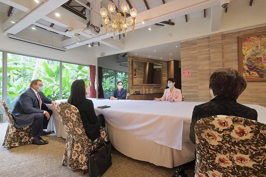 Second Minister for Finance Indranee Rajah (in pink) and Infrastructure Asia executive director Seth Tan (beside her) at yesterday's meeting at the Singapore Botanic Gardens with Asia Sustainable Infrastructure Advisory Panel members (from left) Scot