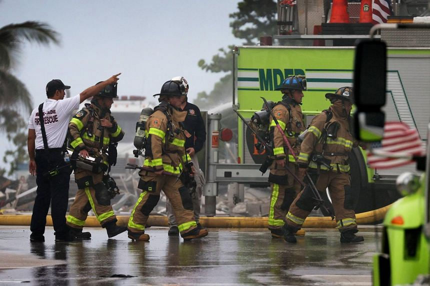 Firefighters are seen during rescue operations at the partially collapsed Champlain Towers South condo building in Surfside, Florida, on June 24, 2021.