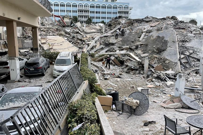 Emergency personnel work at the site of a partially collapsed building in Surfside near Miami Beach, Florida, on June 24, 2021.