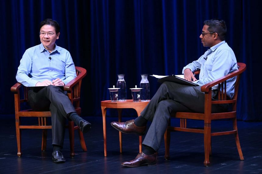 Moderator Shashi Jayakumar (right) asks Finance Minister Lawrence Wong at a forum why an individual from a minority race can't be the prime minister.