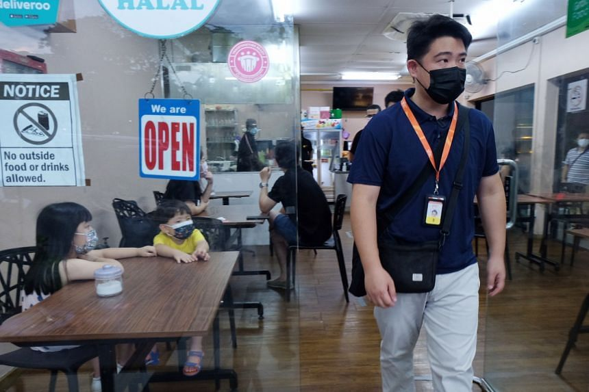 A Singapore Food Agency officer during an operation at an F&B outlet on June 26, 2021.