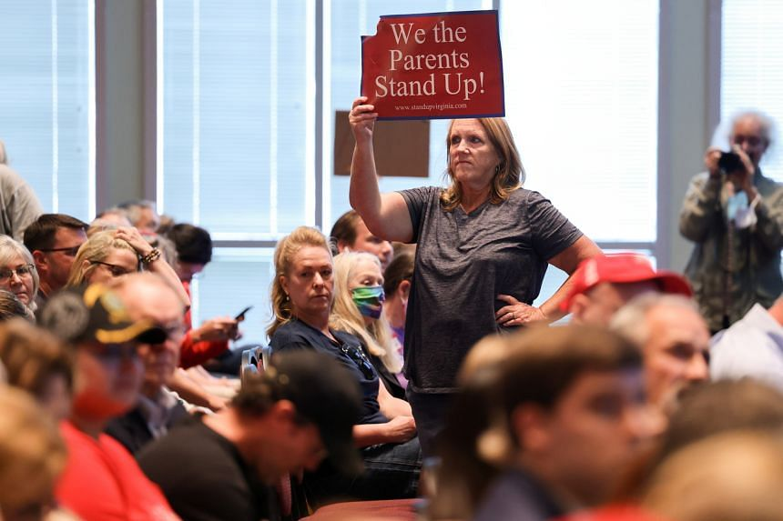 Opponents of an academic doctrine known as critical race theory attend a packed Loudoun County School board meeting, in Ashburn, Virginia, on June 22, 2021. PHOTO: REUTERS
