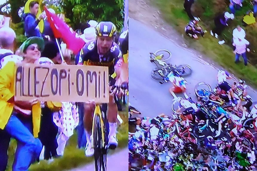 Rider Tony Martin ran into a sign held up by a spectator at the start of the race (left), which caused a huge pile-up (right)