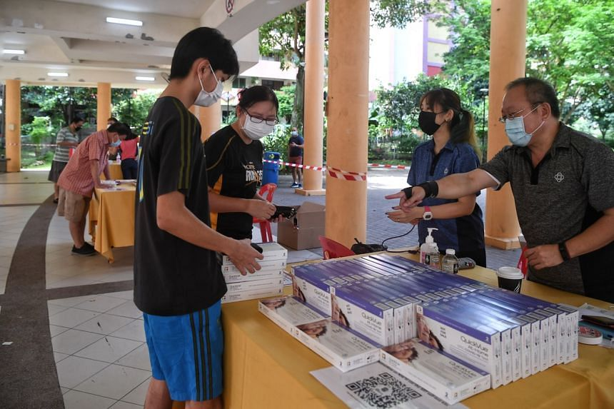 Residents collecting their antigen rapid test self-test kits at the pavilion at Block 128 Bukit Merah View on June 26, 2021.