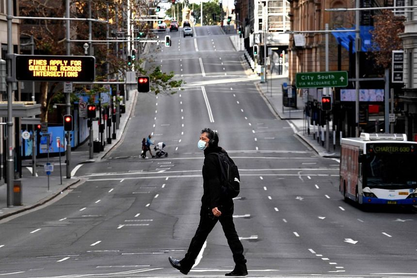 A man walks along the main road in the central business district of Sydney, on June 26, 2021.