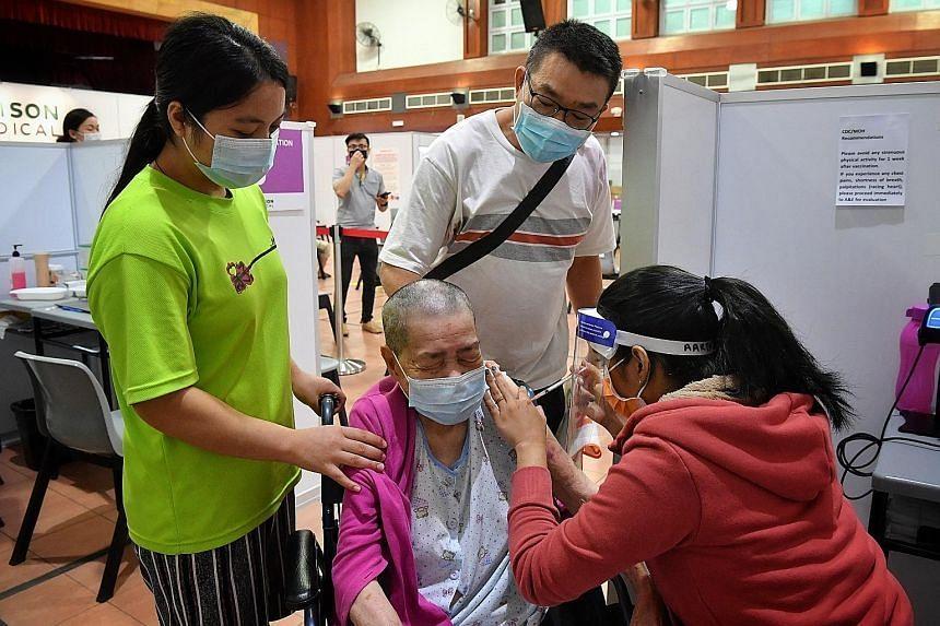 Madam Chan Ah Wong, 88, receiving her jab yesterday at Potong Pasir CC.