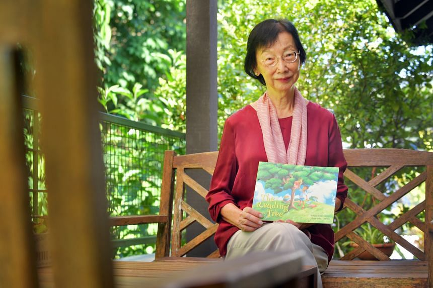 Dr Khoo Kim Choo with her latest book The Reading Tree, which is about the friendship between a boy and a talking tree.