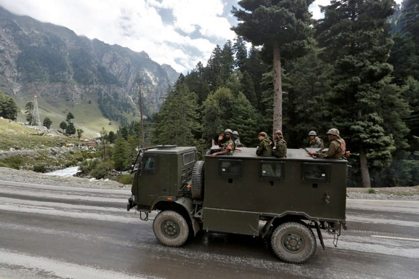 Indian army soldiers in a vehicle on a highway leading to Ladakh, at Gagangeer in Kashmir's Ganderbal district on Sept 2, 2020.