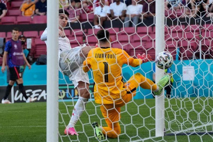 Spain's forward Alvaro Morata scores in offside position at the Parken Stadium in Copenhagen, on June 28, 2021.