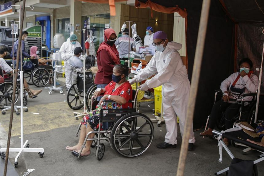 Indonesia has reported record daily Covid-19 infections of more than 20,000 in recent days.