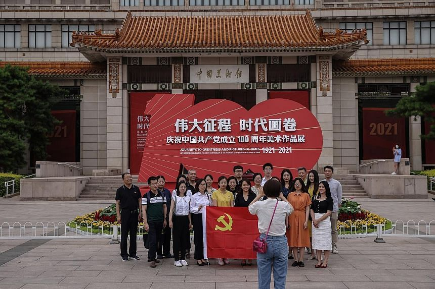 A group photo being taken at the National Art Museum in Beijing on June 24, 2021.
