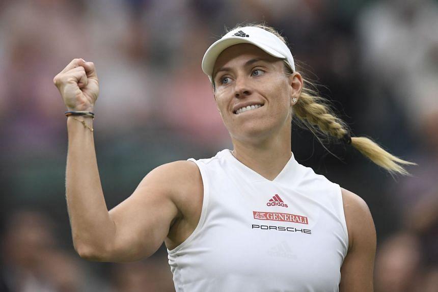 Kerber celebrates her win against Nina Stojanovic of Serbia.