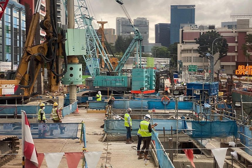 Workers at a construction site at Thomson Road on June 15. NTUC will work with affiliated unions to push for safety time-outs at all high-risk worksites, where site practices and risk assessments can be reviewed, said its assistant secretary-general