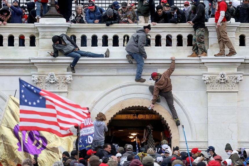 Supporters of then President Donald Trump storming the Capitol in Washington, DC, on Jan 6, 2021. The attack left five dead.