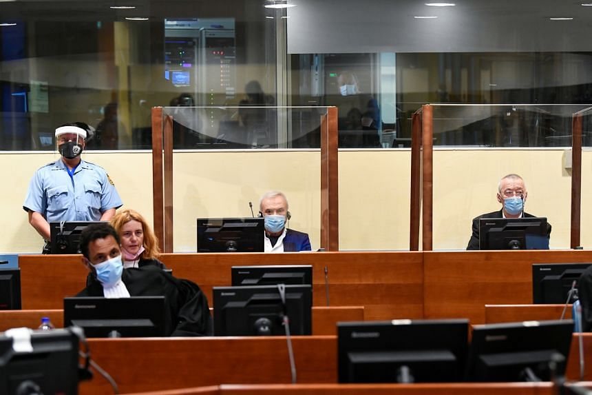 """Jovica Stanisic, and his subordinate Franko """"Frenki"""" Simatovic appear in court in The Hague on June 30, 2021."""