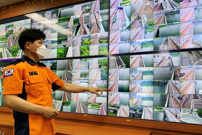 Head of Yeouido Water Rescue Brigade, Mr Kim Hyeong-gil, monitors CCTV footage of bridges along the Han River in Seoul on June 30, 2021.