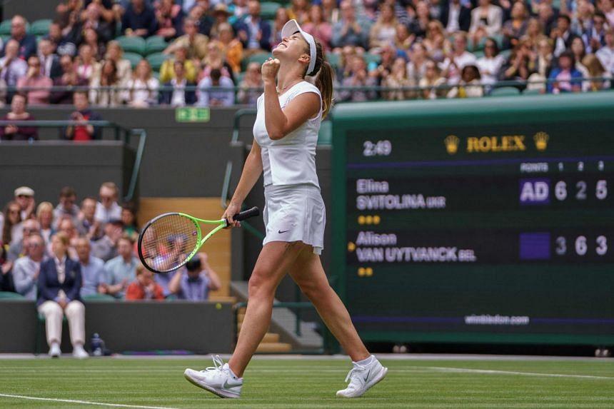 Elina Svitolina celebrates her win over Belgium's Alison van Uytvanck.