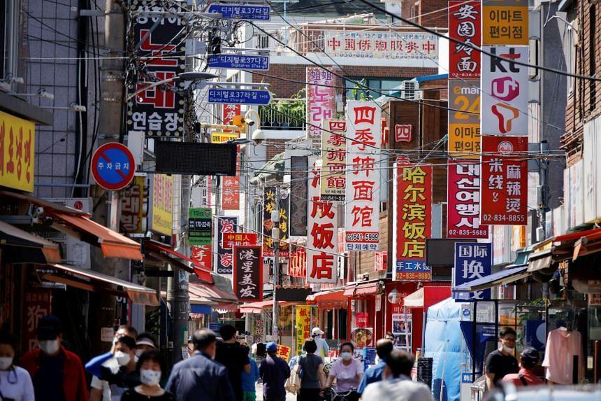 Residents walk in Seoul's Chinatown neighbourhood on June 16, 2021.