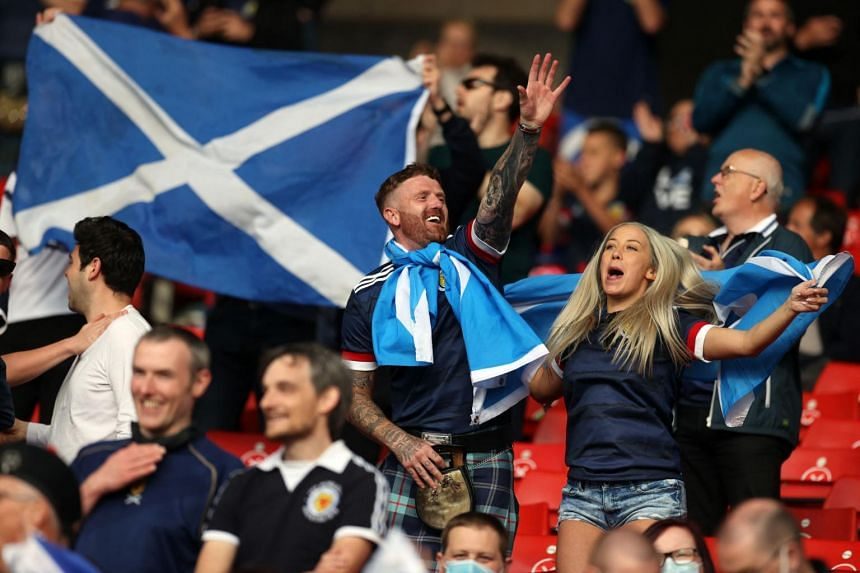 Scotland supporters cheer ahead of the Euro 2020 match against Croatia at Hampden Park in Glasgow on June 22, 2021.