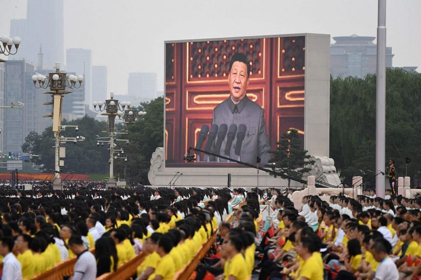Mr Xi Jinping speaking as thousands celebrate the Chinese Communist Party's centenary in Tiananmen Square on July 1, 2021.