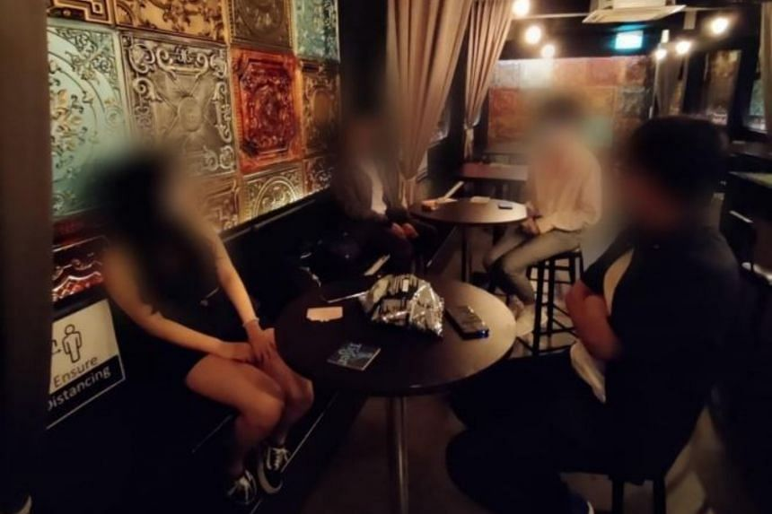 A group of four people were found intermingling across two tables at Ebar on June 26, 2021.