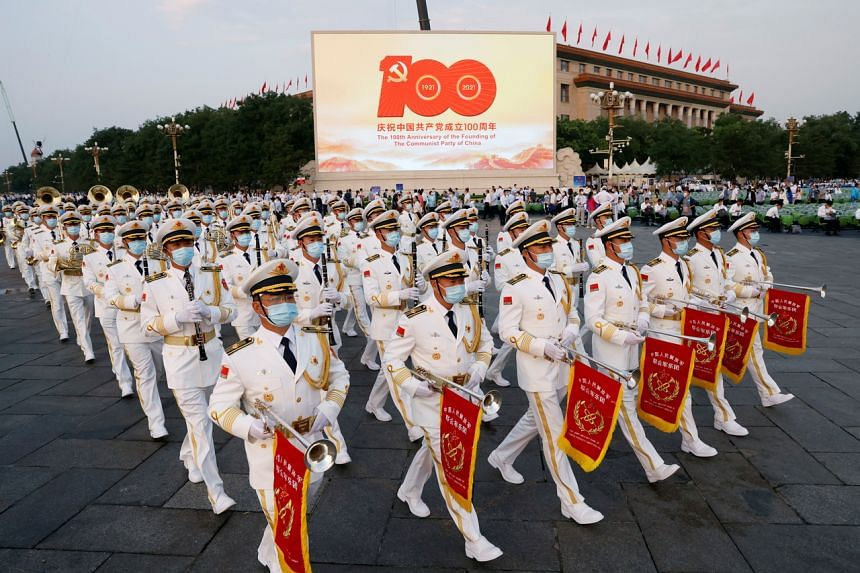 Military band members rehearse before the event marking the centenary of the Communist Party of China at Tiananmen Square in Beijing on July 1, 2021.
