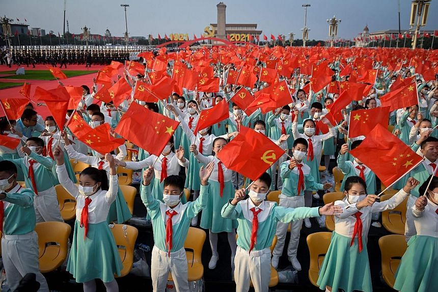 """Balloons being released at the end of the centenary event yesterday. Apart from hailing former Chinese leaders, Mr Xi also honoured the Chinese people, whom he described as """"the creators of history"""" and """"the true heroes"""". PHOTO: REUTERS Chinese Presi"""