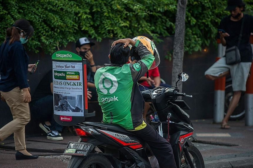Value of ride-hailing giant Grab's merger with United States special-purpose acquisition company Altimeter Growth Corp. ST FILE PHOTO Value of the merger of Grab's Indonesian rival Gojek with Indonesian e-commerce firm Tokopedia. PHOTO: AGENCE FRANCE