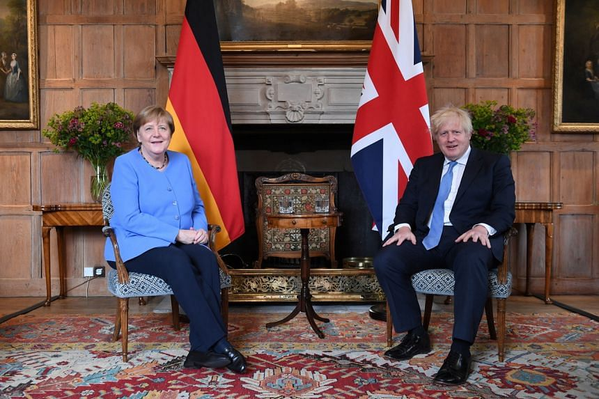 German Chancellor Angela Merkel meets Britain's Prime Minister Boris Johnson at Buckinghamshire, Britain, on July 2, 2021.