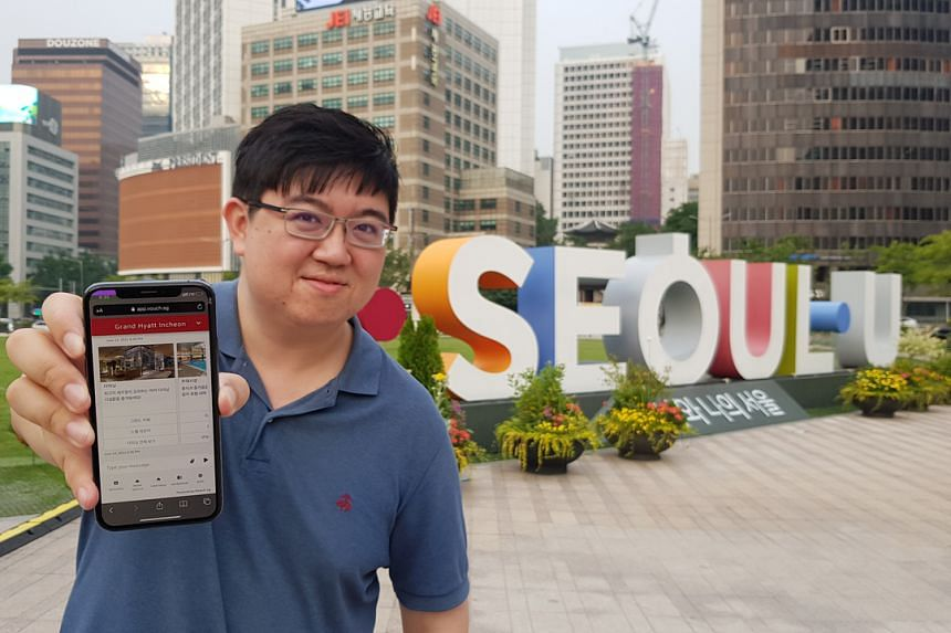 Daniel Lee, Korea manager of Vouch, poses with a digital concierge platform that was built for Grand Hyatt Incheon.