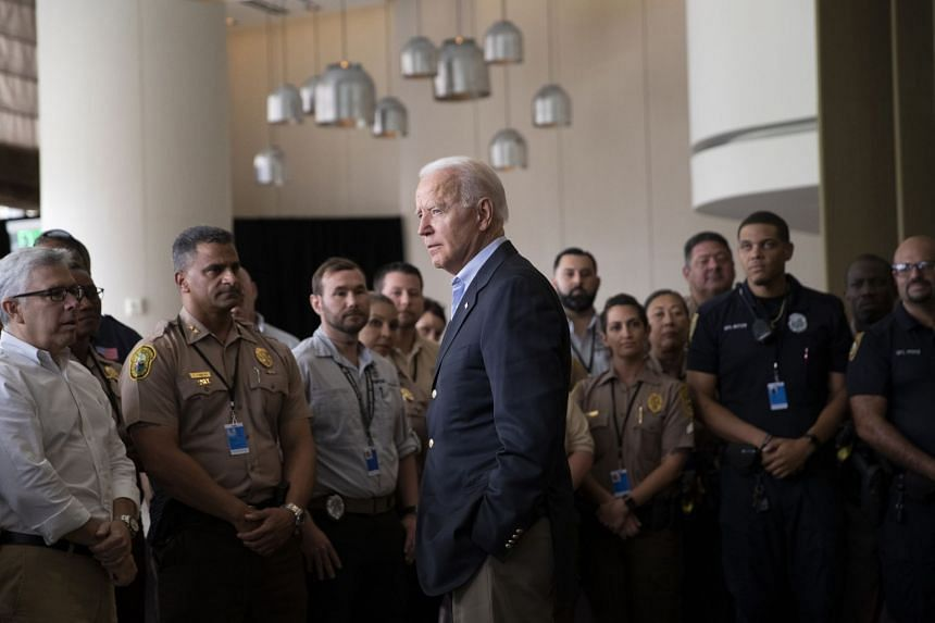 US President Joe Biden greets first responders at a hotel in Bal Harbour, Florida, on July 1, 2021, as he visits the area near the partially collapsed Champlain Towers South condo building in Surfside, Florida.