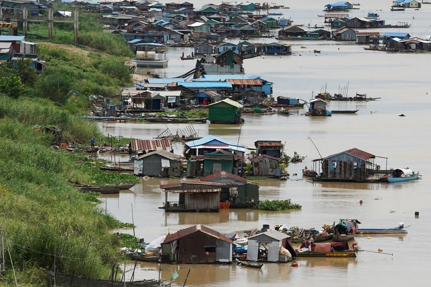 Floating houses are seen on the Tonle Sap River in Phnom Penh on June 12, 2021.