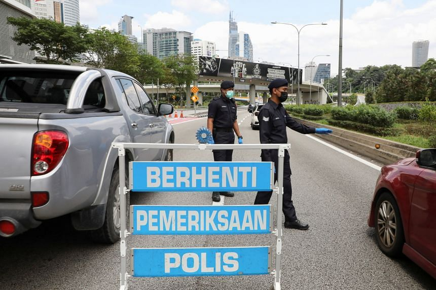 A police roadblock in Kuala Lumpur on July 3, as stricter Covid-19 restrictions came into effect in parts of the Malaysian capital.