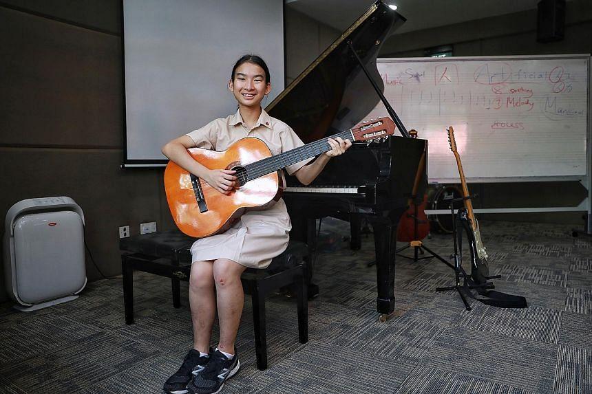 Left: Hwa Chong Institution JC student Jayne Peh, 17, plays both the piano and guitar. Below: CHIJ (Kellock) pupil Bheema Lokesh Yuktha, nine, with her artwork Pistafish. PHOTOS: KEVIN LIM, MOE
