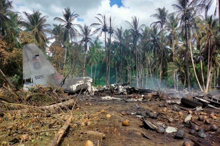 View of the site after a Philippines Air Force Lockheed C-130 plane crashed on landing in Patikul, Sulu province, Philippines, on July 4, 2021.