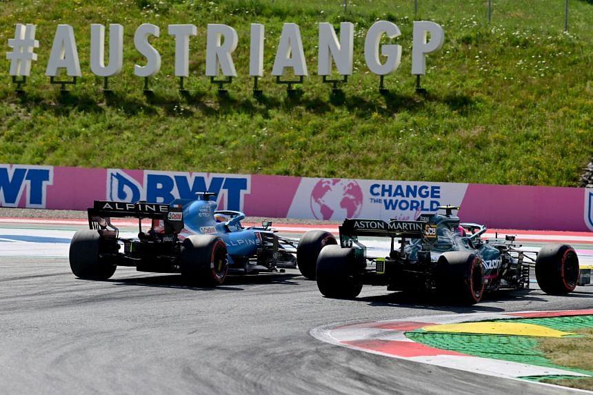 Alpine's Fernando Alonso (left) and Aston Martin's Sebastian Vettel drive during the qualifying session.