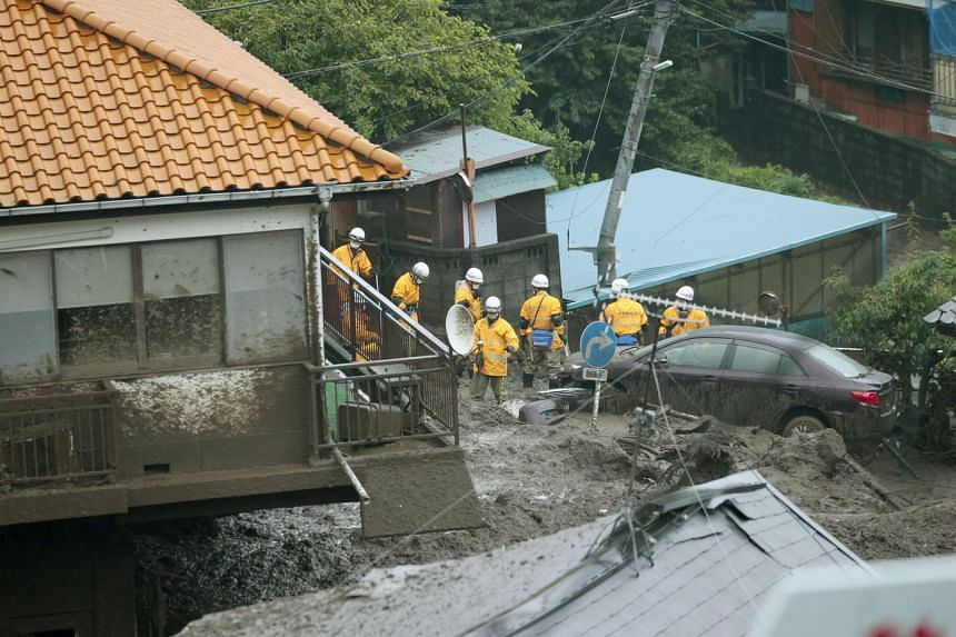 Firefighters conduct a search and rescue operation at a mudslide site in Atami on July 4, 2021.