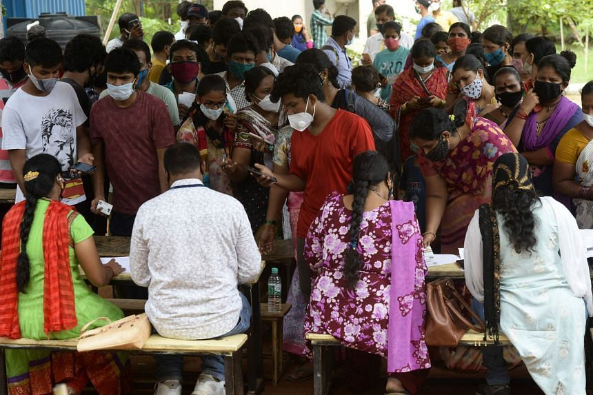 Residents lining up to register for a dose of the Covaxin vaccine during a vaccination drive at a school in Hyderabad on July 1, 2021.